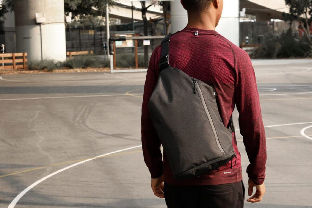 How to wear a sling backpack?